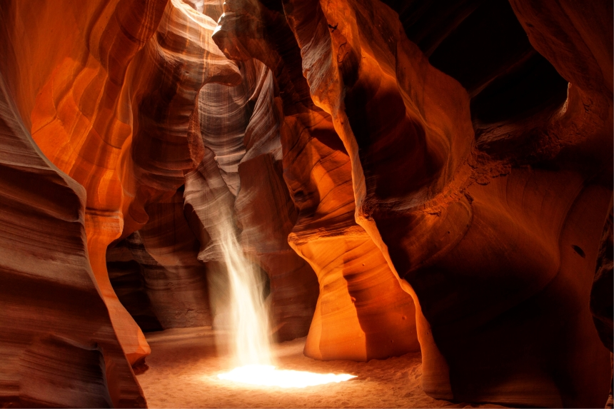 antelope canyon light beam with sand